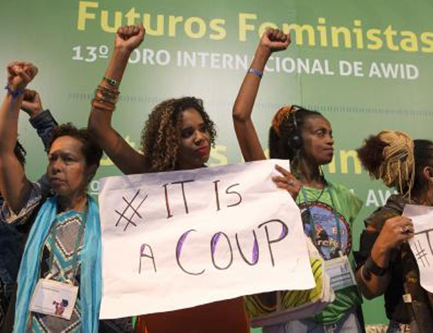 "2016 AWID Forum participants holding a sign: ""This is a coup"" (610x470)"