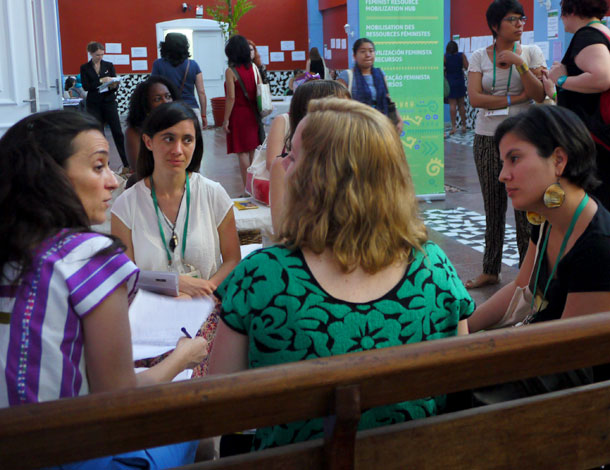 Participants at the 2016 AWID Forum, chatting in the hallway (photo: Cécile Pillon-Hue) - 610x470