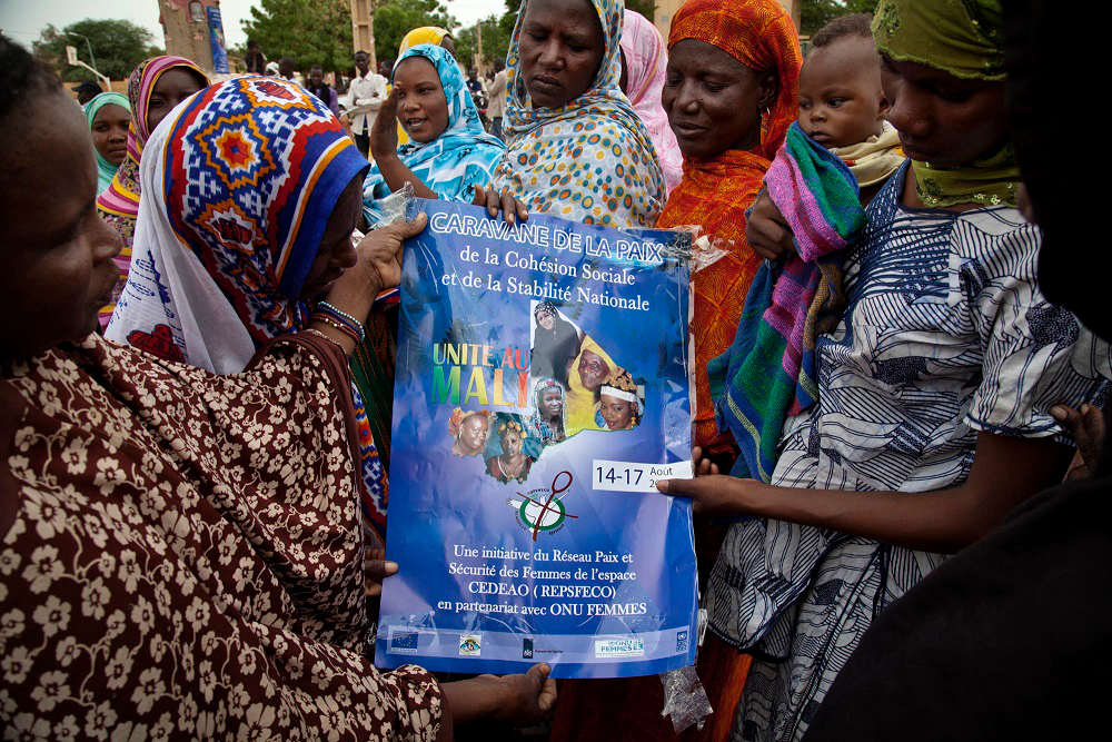 Mali women with sign