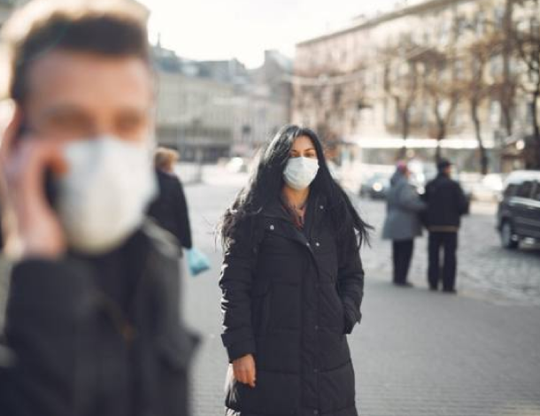 RFM - Autonomous Resourcing (woman walking in the street with a mask over her mouth)