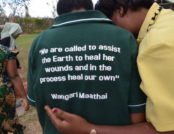 "Women human rights defenders at an AWID meeting in Kenya - On the back of her shirt, a quote from Wangari Maathai: ""we are called to assist the Earth to heal her wounds and in the process heal our own"""