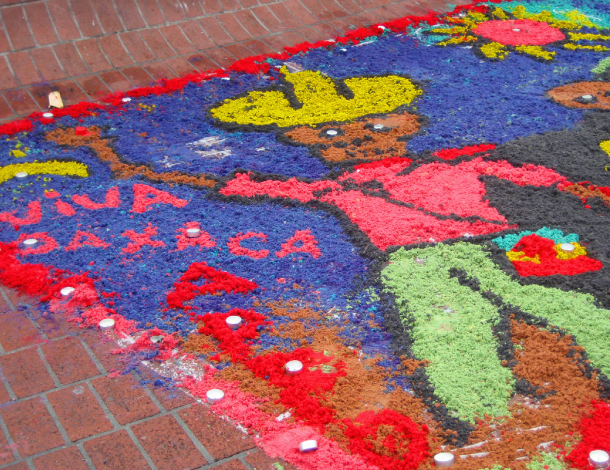 "Art work on sidewalk saying ""Viva Oaxaca"" (610x470)"