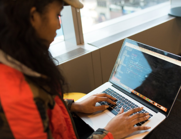 Working- remotely: woman typing on a laptop - seen above her shoulder - photo by Christina from Unsplash - 610x470.png