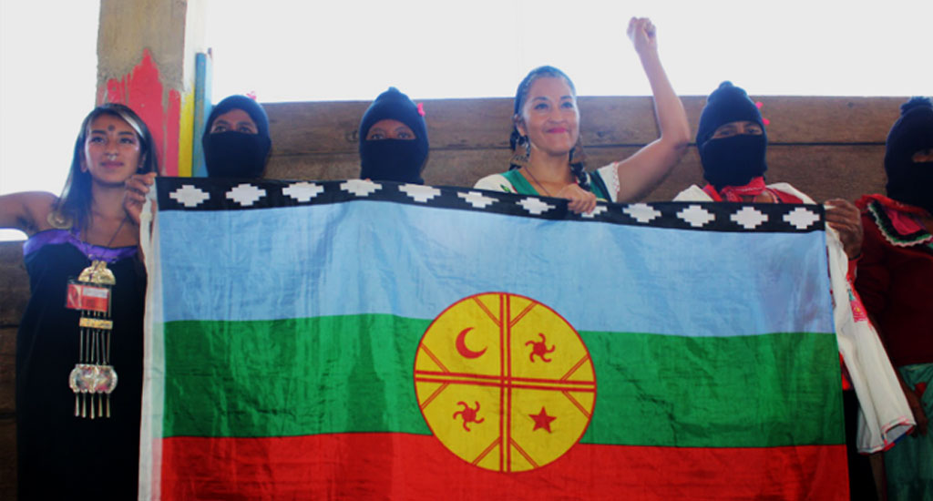 Zapatista women -  Mapuche nation flag with Moira Millán (1024x550